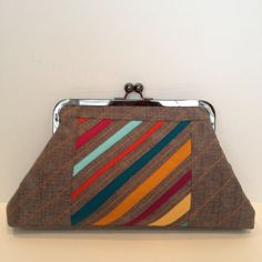 https://flic.kr/p/bmosUU | framed clutch | Using scrap solds and some quilter's linen I made a quick framed clutch.