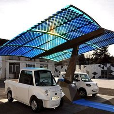 A standalone, mobile station that replenishes electric vehicles using solar energy, and provides shade too. Very ninja.    Photo: Tatmouss on Wikipedia. #smartcommunity
