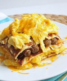 Breakfast Lasagna    Ingredients:  8 eggs, scrambled  1 cup shredded cheddar cheese  12 sausage links, fully cooked  12 cream cheese pancakes (unsweetened)  Cover the bottom of an 8 x 8 pan with 4 pancakes, it's ok if they overlap.  Put down a layer of scrambled eggs, followed by a layer of cheese.  Cover with another 4 pancakes.  Add all of the