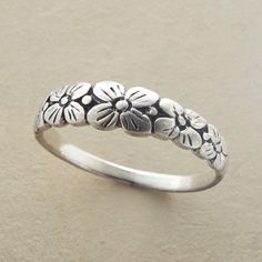 BOWER OF FLOWERS RING--Our exclusive, handcrafted sterling silver flowers ring blooms into an enchanting bower of blossoms as it rounds the finger. Handcrafted of sterling silver. Whole sizes 5 to 10.