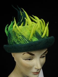 Green spiky hand felted hat.