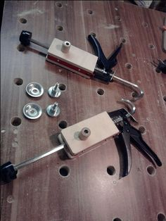 Clamps made from caulking guns.