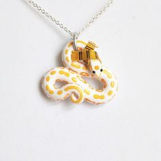 Harry Potter Inspired Snake Necklace from Polymer Clay by The Clay Kiosk on Etsy.
