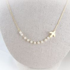 Airplane Necklace With White Pearls – AppleLatte