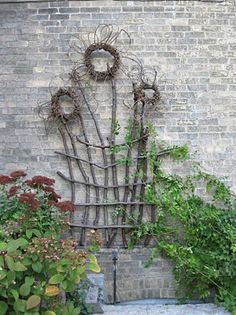 Garden trellis made from old branches and grapevines