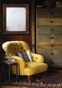 Yellow chair in rustic home.