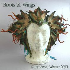 Roots & Wings Crown    One of a kind leather bird mask and crown set. Hand sculpted, embossed and painted in autumn hues. The set is embellished with sculpted leather branches and twigs, layers of intricate featherwork, vintage brass filigree and genuine turquoise and jasper. The crown is shown alone in this image.