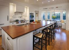 Timeless in its appeal, this new construction, turn-of-the-century-style home boasts a kitchen with several custom touches that help to create an overall aesthetic of a home that has been slowly added to over time. Surrounded by Marvin windows, the breakfast nook confirms a sense of community and sharing present in the kitchen.   - HouseBeautiful.com
