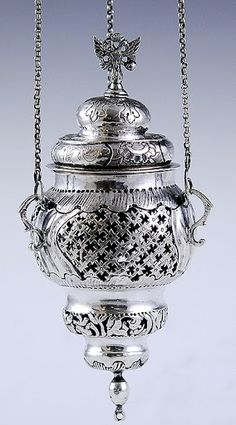 1779 Russian Orthodox silver thurible. A thurible is an incense censer suspended from chains, often used in religious ceremonies. The thurible is done with beautiful pierced work, nice hand-chasing and hand stippled borders. The inside of the lid has a pierced grill with a small door with a latch.