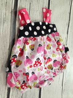Ladybug Ruffled Bum Reverse Knot Sunsuit Bubble Romper - how cute is this ladybug print?  And the back ruffles are done in 3 different fun prints.  Over. The. Top.