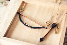 Bow and Arrow Tribal Feather Necklace  layered by StrangelyYours, $23.90