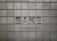 Japanese designer Yota Kakuda used a bespoke aluminium tile to cover the walls and floors in this shop that sells baked cheese tarts Bake Cheese Tart, Cheese Tarts, Baked Cheese, Retail Signage, Wayfinding Signage, Signage Design, Storefront Signage, Restaurant Signage, Banner Design