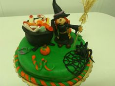 Halloween cake for my daugther's Halloween party at school! The which's pot is full of candy :)