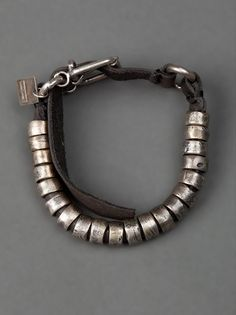 GOTI, LEATHER BRACELET: silver hoops and buckle.