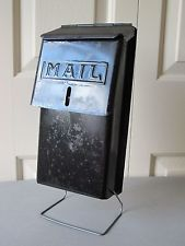 Vintage black metal mailbox locking capability