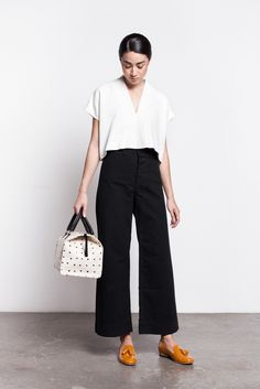 white blouse with cropped black pants and tasseled loafers