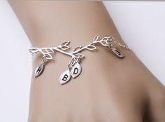 Family Tree bracelet,Leaf initial,Custom initial bracelet,Grandma jewelry,Mother Jewelry,Anniversary,Mom and Baby by Birdedenjewelry on Etsy https://www.etsy.com/listing/117203793/family-tree-braceletleaf-initialcustom