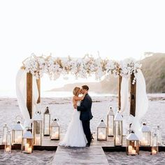 Beautiful beach wedding Arch set-up. Love the flowers and lanterns and the finished look with the risers in the sand! Wedding 2017, Wedding Goals, Wedding Themes, Summer Wedding, Wedding Ceremony, Wedding Planning, Dream Wedding, Wedding Ideas, Beach Ceremony