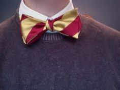 uncool: bright shiny silk tie, white shirt + pullover {pair with jeans, non-white shirt + choose wool over silk unless you're going for very preppy}