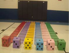 Racetrack game played with jumbo dice - roll your dice and move that many spaces- who ever makes it to the end wins the prize
