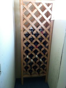 Like the idea of using part of a garden trellis for wine storage- i would attach it to a bookcase so that I could have room to store cookbooks also