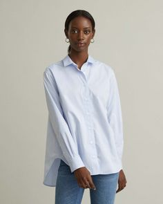 A timeless crisp cotton poplin shirt that can instantly elevate any pair of jeans. Featuring a modern relaxed silhouette for the most effortless look. Spread collar Button front Tonal logo embroidered at front Rounded hem Personal Shopping, Designing Women, Poplin, Crisp, Capri, Silhouette, Apothecary, Jeans, Modern