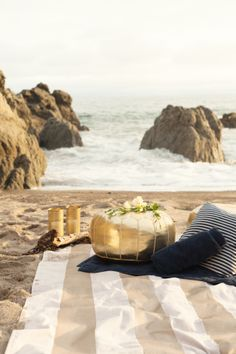 #gold, #beach, #ocean, #picnic, #stripes, #pouf  Design & Styling: Aaron Hartselle - aaronhartsellecreative.com/ Photography: Justin Sullival - justinsullivanphoto.com/  Read More: http://www.stylemepretty.com/living/2013/07/03/a-glam-4th-of-july-picnic-a-diy-from-aaron-hartselle/