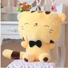 Description: 45CM Lovely Big Face Smiling Cat Stuffed Plush Toys Soft Animal Dolls Factory Lowest Price Best Gifts for Kids High Quality. Features: Size: 45cm (with tail), sitting size: 28cm Material: