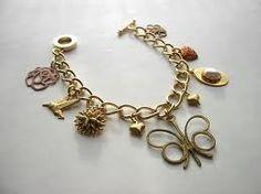 Antique Charm Bracelet! I love them & must finish mine! Ax