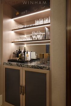 Bar shelving and cupboard unit with marble surface
