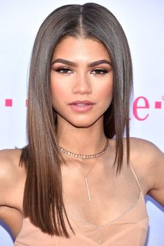 ZendayaJust when we think we can spot Zendaya on the red carpet, she majorly changes her look again. After making a bowl cut look crazy-chic at the Met Gala, the actress surprises us with straight and shiny long locks, accented with strong eyebrows and rose-toned makeup. #refinery29 http://www.refinery29.com/2016/05/111630/best-makeup-billboard-music-awards-2016#slide-9