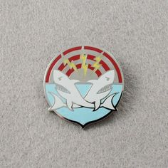 """Channel your inner shark. Details - Zinc alloy, enamel - Color: Silver with color enamel - Dimension: 31mm x 33mm/ 1-1/4"""" x 1-3/8"""" - Safety pin backing - Imported **This pin is handmade and has underg"""