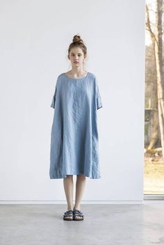Washed and soft linen dress with drop shoulder short sleeves. The dress is little A - line shape and can be worn with the belt or without. The belt is included. The length of the dress is +/- 38.5  (98 cm). The length of the dress to 110 cm is free of charge, so please leave a note if