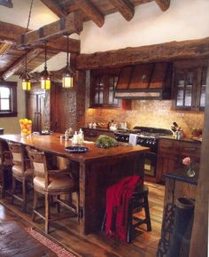 This would be my favorite kitchen... with a darker, old wood floor.  Maybe a creepy old black iron chandelier... switch out the light fabric on the chairs and put on dark leather...  Awesome!!
