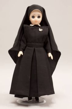 Doll wearing habit worn by Daughters of St. Paul :: Catholic Sisters International