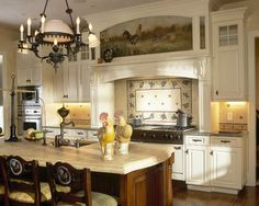 French Country Kitchen Cabinets Design. Don't you love the warmth of the painting above the stove.  So unique.