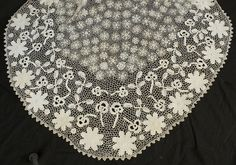 c.1910 Irish crocheted lace jacket.The jacket has all the attributes favored by serious collectors: a variety of large three-dimensional motifs in a pleasing arrangement. In the bottom detail picture, you can see at least five floral motifs (flowers, sprigs, leaves) differentiated by size and orientation along the vertical design axis. Detail