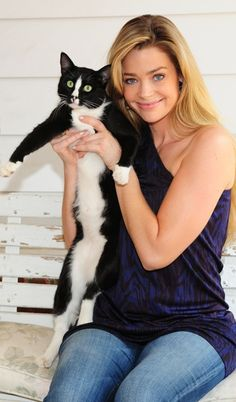 Denise Richards - the contrast between her expression and her cat's is great.