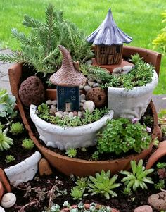 Clay houses in tiered succulent garden.