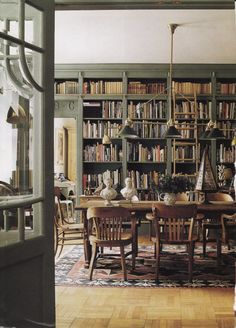 This library, painted Farrow & Ball's 'Sutcliffe Green' is in England, on the Norfolk/Suffolk border to be exact. Called Blo' Norton Hall, it is the home of Charles and Rachel Morris.