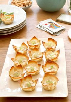 Baked Crab Rangoon -- What's old is new again, and so's this classic appetizer recipe. Crispy won ton wrappers hold a creamy mixture of crab meat for a better-for-you bite that will never go out of sty...