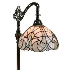 Opaque stained glass graces the top of the elegant shade of this lamp, juxtaposed with clear white glass and iridescent on the borders for a truly polished look. Give your home a classic accent with this Tiffany style lamp featuring 144 glass pieces and 12 beads.