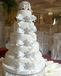 white wedding cakes  | tier brooch white wedding cake with white roses and bows