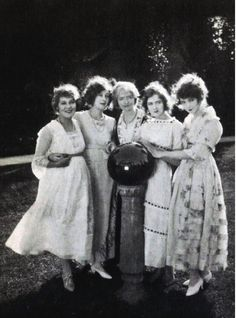 From left to right- Mary Pickford, Mildred Harris with Mary, Dorothy, and Lillian Gish