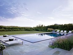 Just a stone's throw from the dunes in Sagaponack, New York, is a beach house that design firm Cullman & Kravis created for a Boston family in collaboration with architecture studio Ike Kligerman Barkley. Surrounding the infinity-edge pool is a bluestone terrace that hosts teak chaise longues by Janus et Cie. Edmund Hollander Landscape Architects oversaw the grounds.