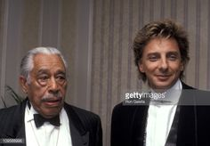 Cab Calloway and Barry Manilow.