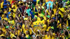 Fans cheer during the 2014 FIFA World Cup Brazil Opening Ceremony at Arena de Sao Paulo