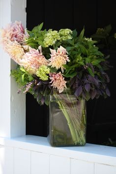 Herbal arrangement of purple basil, mint and cafe au lait dahlias - by Botany Flowers