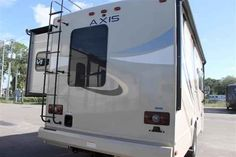 """2016 New Thor Motor Coach AXIS 25.3 Class A in Florida FL.Recreational Vehicle, rv, 2016 THOR MOTOR COACH AXIS25.3, 12V Attic Fan in Bedroom, 12V Attic Fan in Living Area, 15.0 BTU A/C, 2nd Auxiliary Battery, 32"""" TV in Bedroom, 32in Exterior TV, Interior- Redwood, Olympic Cherry Cabinetry, Vanilla Ice Exterior,"""