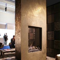 Make your home look amazing with concrete! - mix gold powder in with concrete to create a gold fireplace!